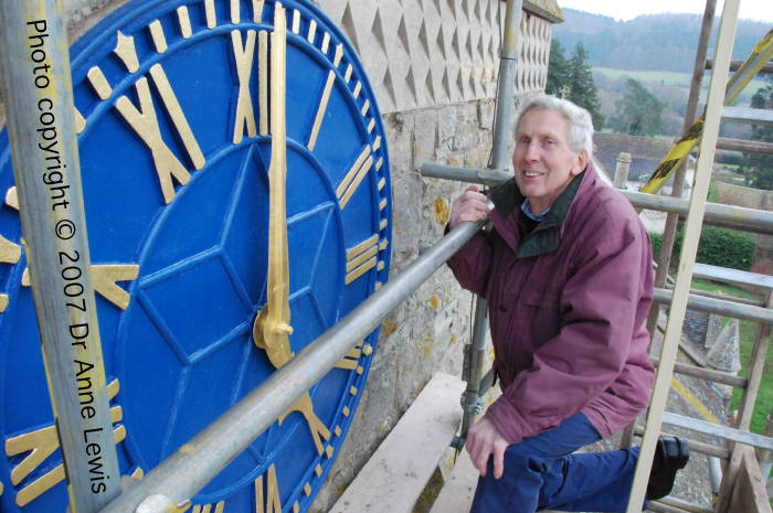 Ivor Bramich and the newly repainted and gilded clock face at Suckley Church. Photo copyright © 2007 Dr Anne Lewis